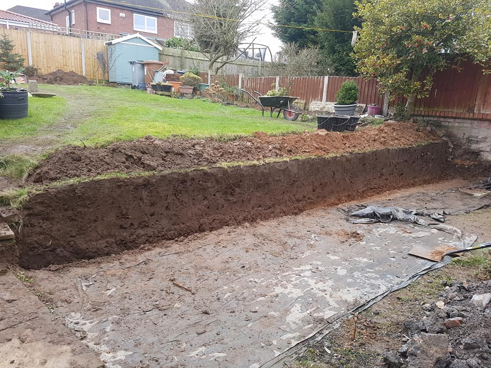 Busy day on the wirral preparing a sandstone wall in a client's garden in bebington. North Wales, North West, Wirral, Liverpool & Cheshire UK