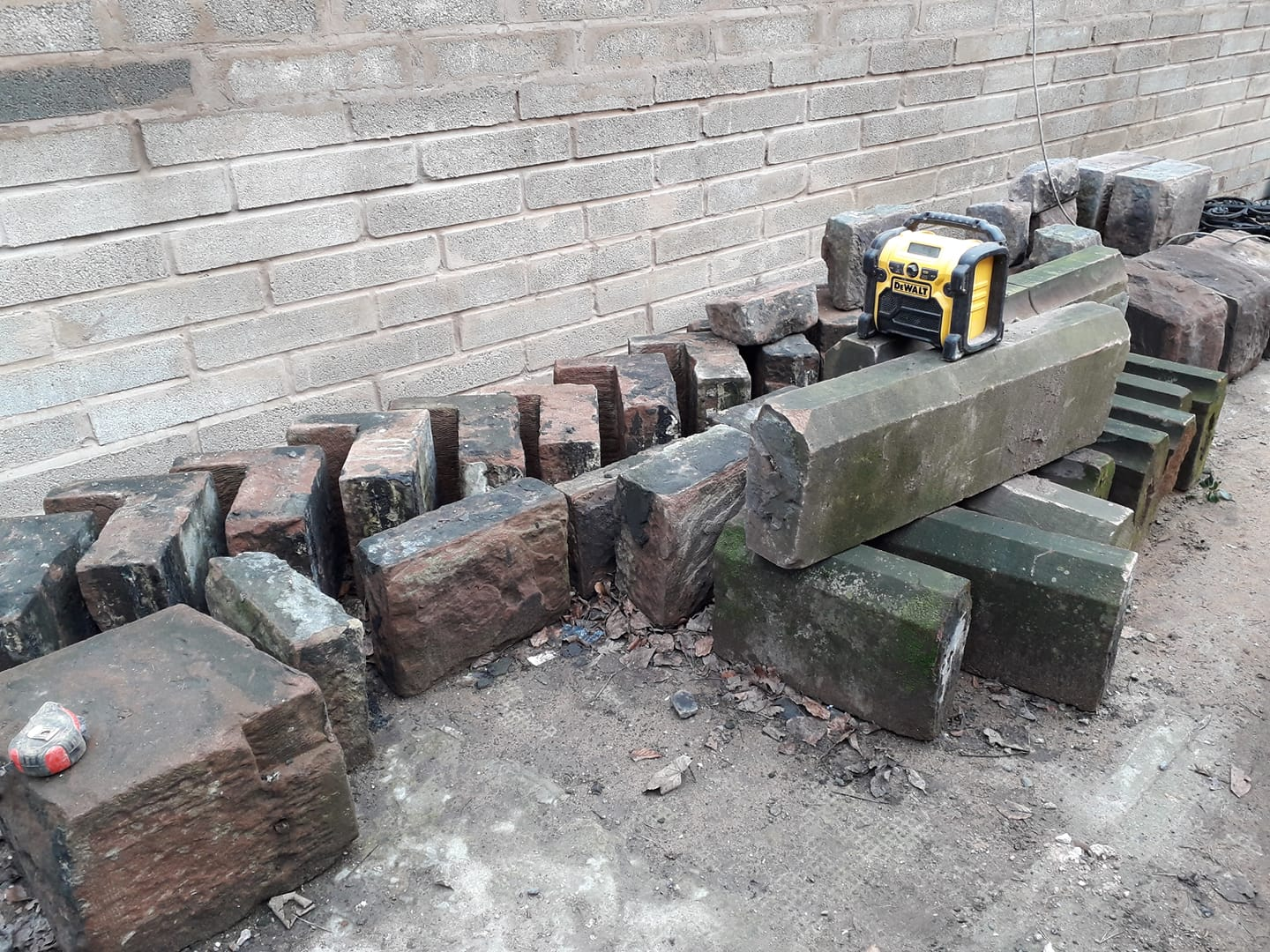 Busy in Liverpool rebuilding a garage wall from a lovely Cheshire red sandstone after altering the entrance size. North Wales, North West, Wirral, Liverpool & Cheshire UK