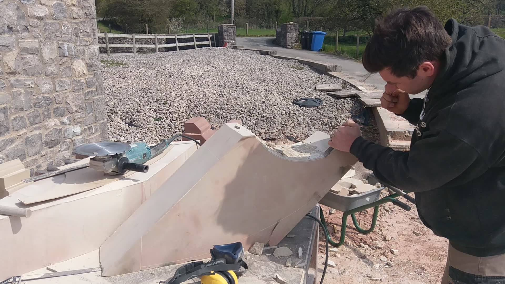 Some roughing out with the 12 inch chissle working down to the lines of this stone section for a tracery window. North Wales, North West, Wirral, Liverpool & Cheshire UK