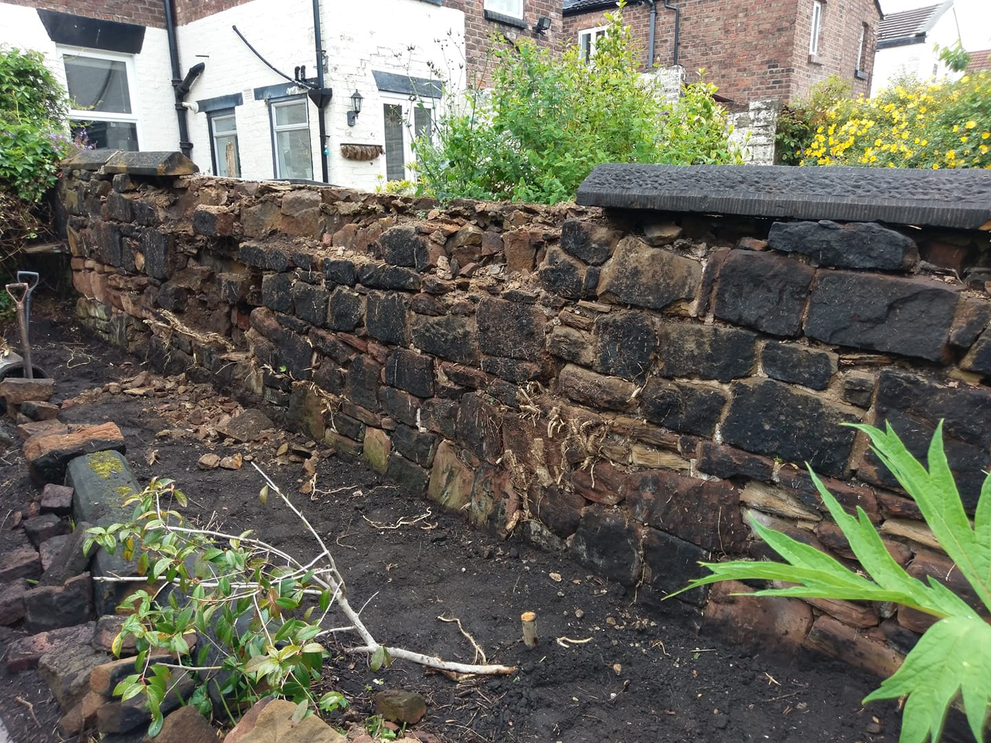 The start of a sandstone wall repair in Liverpool after Ivy damage over many years of growth. North Wales, North West, Wirral, Liverpool & Cheshire UK
