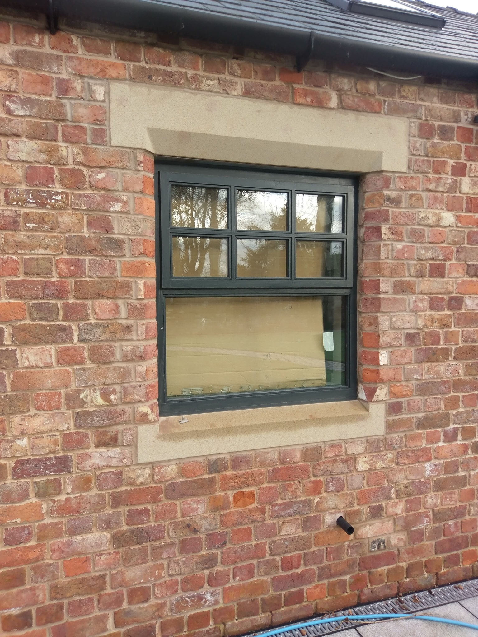 A sandstone lintel and cill we supplied to a customer in liverpool last year fitted into an new kitchen window opening. North Wales, North West, Wirral, Liverpool & Cheshire UK