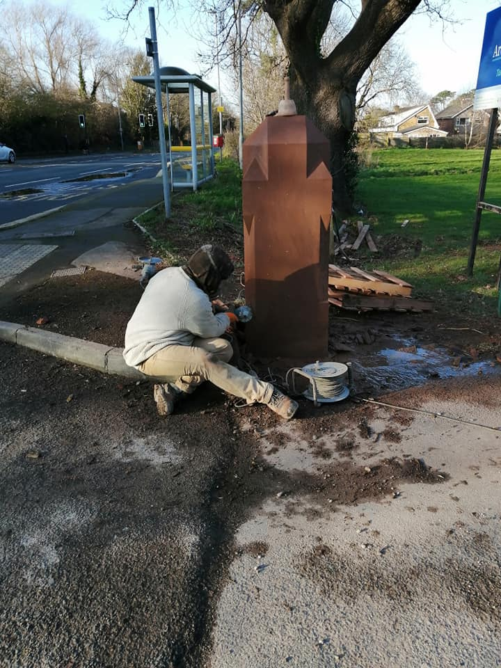 Two sandstone gate posts being supplied and fitted to a school on the wirral. These posts are 1.5 ton each and carved in situ. North Wales, North West, Wirral, Liverpool & Cheshire UK