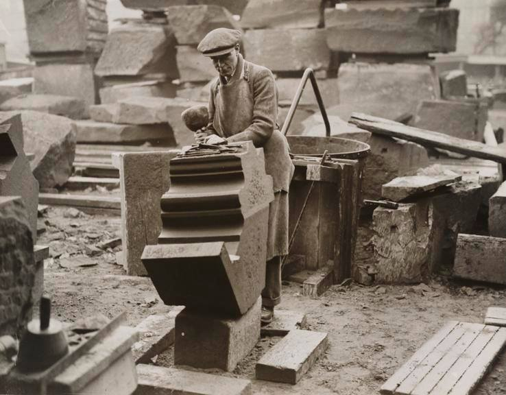 Fantastic historic photo of a traditional stone mason working on a section for the Liverpool cathedral. North Wales, North West, Wirral, Liverpool & Cheshire UK